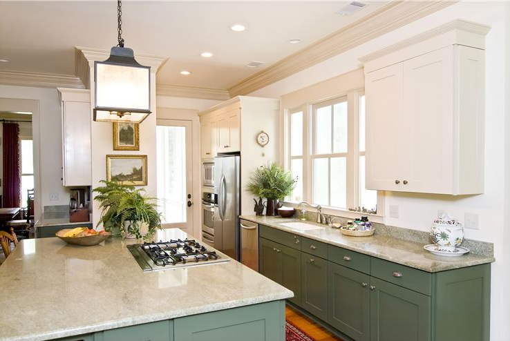 Kitchen with crown moulding around ceiling
